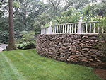 stone wall with fence on top
