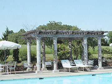 Pool side pergola with clay columns
