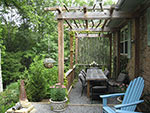 wood arbor over dining table